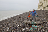Waste collection on the beach of Pourville-sur-Mer, Normandy, France