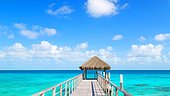 Fare at the end of a pontoon and turquoise sea, Rangiroa, French Polynesia