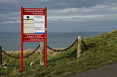 Information panel on the dangerous edge of the cliffs on the heights of Tréport, Normandy, France