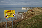 Information sign indicating that the cliff is unstable on the heights of Tréport, Normandy, France