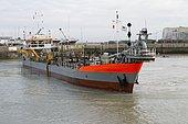 Dredge maneuvering in the port of Tréport, Normandy, France
