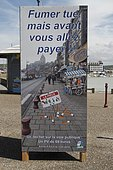 Information panel on the price of fines for the lack of respect for cleanliness in town at Tréport, Normandy, France
