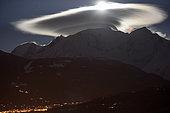Mont Blanc massif with cap cloud lit by the moon, Saint-Gervais-les-Bains, Haute-Savoie, France, april 1st, 2018
