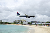 Airliner landing at Saint Martin airport, West Indies