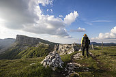 Hiker on the ridge path of the Font d'Urle plateau, Vercors Regional Natural Park, France