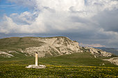 """Direction post of the discovery trail called """"sentier du Karst"""", in the background the Puy de la Gagère, Font d'Urle plateau, Vercors regional natural park, France"""