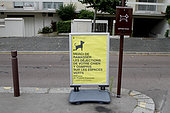 Information board on dog excrement in urban areas in Versailles, Ile-de-France, France
