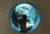 Girl watching a fish, Aquarium of Noumea. New Caledonia.