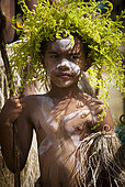 Portrait of young dancer with fern crown, cultural festival. Common Poya. New Caledonia.