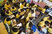 Children reading in a school, Efate Island, Vanuatu