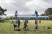 Children playing football in a school, Efate Island, Vanuatu