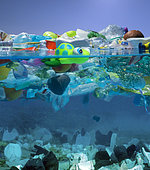 Plastic toy turtle and other plastic garbage floating in the ocean. Unlike organic debris, which biodegrades, the photodegraded plastic disintegrates into smaller and smaller pieces and it concentrates in the upper water column. As it disintegrates, the plastic ultimately becomes small enough to be ingested by aquatic organisms that reside near the ocean's surface. In this way, plastic may become concentrated in neuston, thereby entering the food chain. While eating their normal sources of food, plastic ingestion can be unavoidable or the animal may mistake the plastic as a food source.