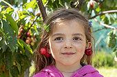Pair of cherries bigarreau 'Burlat' in earring, spring, Pas de Calais, France