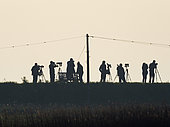 Birders bird watching on West Bank at Cley Norfolk May