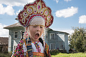 Little Russian girl in the city of Uglish in traditional dress