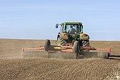 Farmer harrowing his harvested field, Franconia, Bavaria, Germany, Europe