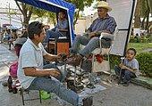 Shoeshine boy at work, Tlacolula, Oaxaca State