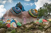 Colorful sculpture, female figure formed like a house, in the Giardino dei Tarocchi or Garden of the Tarot, by Niki de Saint Phalle and Jean Tinguely, in Capalbio, Province of Grosseto, Tuscany, Italy, Europe