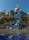Fountain and colorful sculptures in the Giardino dei Tarocchi or Garden of the Tarot, by Niki de Saint Phalle and Jean Tinguely, in Capalbio, Province of Grosseto, Tuscany, Italy, Europe
