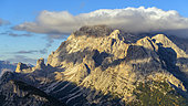 Mount Cristallo in the Dolomites Massif seen from the foot of the Tre Cime of Lavaredo, in the distance, the Cadini of Misurina and Mount Cristallo, Parco naturale of the Tre Cime, Massif of the Dolomites, Tyrol, Italy