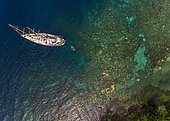 Tara Pacific expedition - november 2017 Tara at anchorage near bubble site, Normanby Island, paoua New Guinea, H: 112,5 m. Mandatory credit line: Photo: Christoph Gerigk, drone pilot: Guillaume Bourdin - Tara Expeditions Foundation