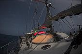 Tara Pacific expedition - november 2017 Solomon Sea Nightly navigation, moonlight. Jonathan Lancelot (watchstanding) Guillaume Bourdin (on the mast)
