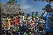 Tara Pacific expedition - november 2017 Yanaba Island, Egum Atoll, Papua New Guinea, A formal meeting was organized amidst traditional huts on stilts overlooking the lagoon. Alfred Yohang Ko'ou (PNG scientific observer) explains reef ecology and Tara's scientific mission to the assembly of Yanaba's inhabitants.