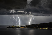 Branched lightning in front of Portofino (Italy). Lightning branched on the sea, facing Portofino (Liguria), during the very electric storm of September 02, 2018