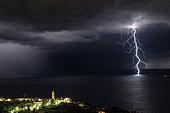 Branched lightning and church in front of Rapallo and near Portofino in Liguria, Italy, during the storm of September 1st.