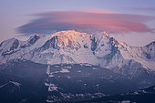 Pink lenticular cloud on the Mont Blanc at the very end of the day, Alps, France, January 25, 2019.