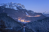 Ski resort Les Carroz, at dusk, and massif of Faucigny, Haute-Savoie, Alps, France