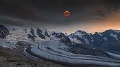 Panoramic view of the Bernina Group with blood moon, Piz Palü, Bellavista, Crast Agüzza, Piz Bernina, Piz Morteratsch, Pers Glacier, Morteratsch Glacier, Diavolezza, Eastern Alps, Engadin, Switzerland, Europe