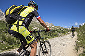 Vallée de la Clarée, mountain bikers on the GR country Tour du Mont Tabor, Névache, Hautes-Alpes, France