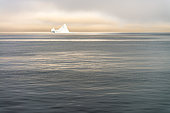 Iceberg drifting at sunrise in Disko Bay, Greenland