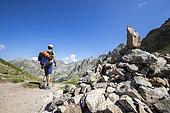A young hiker crossed the Baisse des Cinq Lacs (2335 m), the Madone de Fenestre valley, Haute-Vésubie, Mercantour National Park, Alpes-Maritimes, France