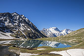 Lake Goléon (2438m) in the massif of Oisans with La Meije and Rake (3809m) in the background, Ecrins National Park, Hautes-Alpes, France