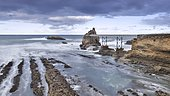 Rocky coastline of the Basque coast at low tide, Biarritz, France