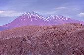 Valle de la Muerte (Valley of the Death), in background volcanoes Licancabur and Juriques, Atacama desert. Region de Antofagasta. Chile