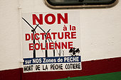 """No to the dictatorship Aeolian"", large sticker claim stuck on the hull of a fishing boat in the Bay of Somme, Picardy, France"