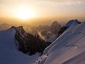 Snowed alpine landscape in the Mont Blanc massif at sunrise