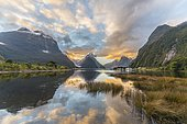 Mitre Peak reflecting in the water, sunset, Milford Sound, Fiordland National Park, Te Anau, Southland Region, Southland, New Zealand, Oceania