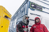 The two managers of postal stewardship (TA64 - TA 65) in front of the postal management of DDU, Dumont-d'Urville Antarctic Base, Terre Adélie, Antarctic