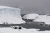 Wordie House, a British Antarctic Survey hut which was in use between 1947 and 1954 and is it now maintained by the Antarctic Heritage Trust as a museum. Winter Islands in the Argentine Islands, Antarctica.
