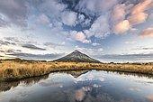 Stratovolcano Mount Taranaki or Mount Egmont reflected in Pouakai Tarn, Mount Egmont National Park, Taranaki, North Island, New Zealand, Oceania