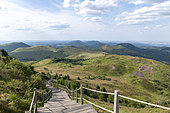Downhill Puy de Dome with a view of the mountains Dore, Auvergne, France