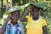 Children playing with leaves, Dominican Republic.