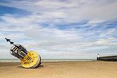 Cardinal buoy stranded on the beach of Calais, Hauts de France, France