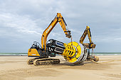 Recovery of a cardinal buoy stranded on the beach of Calais, Hauts de France, France