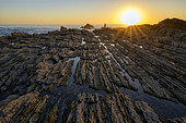 Spectacular flysch formations in southern Portugal, The flysch result from repeated submarine avalanches over millions of years, depositing alternating strata of limestone, marl and sandstone, Praia de Amoreira, Portugal