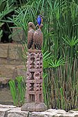 Malagasy Kingfisher (Alcedo vintsioides) on a traditional carved wooden base in Antsirabe, Madagascar